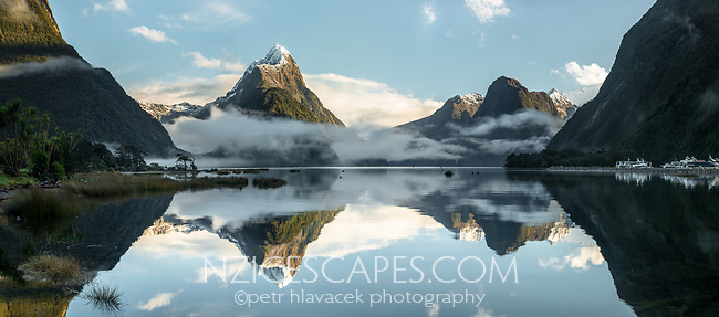 Calm reflections of Mitre Peak in Milford Sound, Fiordland National Park, Southland, UNESCO World Heritage Area, New Zealand, NZ