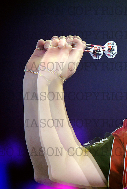 FRIMLEY, ENGLAND - JANUARY 08:  (EDITORS NOTE: This image was created using multiple exposures in camera) Martin Adams of England throws during his Men's  first round match against Ryan Joyce of England on Day Two of the BDO Lakeside  World Professional Darts Championships at The Lakeside Country Club on January 8, 2017 in Frimley, England. (Leo Mason Photo by Split Second/Corbis via Getty Images)