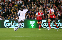 Pictured: Bafetimbi Gomis of Swansea (L) against Craig Morgan of Rotherham (R). Tuesday 26 August 2014<br /> Re: Capital One Cup, Swansea City FC v Rotherham at the Liberty Stadium, south Wales