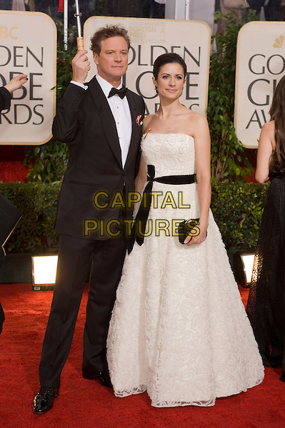 COLIN FIRTH & LIVIA GIUGGIOLI.Arrivals at the 67th Golden Globe Awards held Beverly Hilton, Beverly Hills, California, USA..January 17th, 2010.globes full length black tuxedo jacket bow tie married husband wife ribbon sash waist white strapless dress clutch bag.CAP/AW/HFPA.Supplied by Anita Weber/Capital Pictures