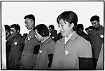 A woman sheds a tear in People's Stadium during the memorial service to mourn Chairman Mao. Harbin, 18 September 1976.