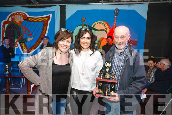 Fleadh by the Feale open air bone playing Competition held Monday night Winner for the ninth time is Paddy O' Donovan from Ardagh being presented with the trophy by Brid Quaide manager AIB Abbeyfeale &amp; Kathy Jordan musician with <br /> Dervish.