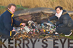 RUBBISH TIP: Pat and Carol O'Shea pointing out some of the burnt rubbish along with some large black refuse sacks, which were left at Derrymore Car Park, on Thursday.   Copyright Kerry's Eye 2008