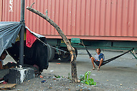poor Man's Home, taken shelter under a truck view from the car window Manila, Philippines