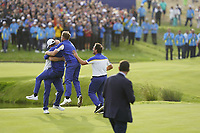 Thorbjorn Olesen (Team Europe)Tyrrell Hatton (Team Europe) Francesco Molinari (Team Europe) jumps on Alex Noran (Team Europe) celebrating his win on the 18th during the singles matches at the Ryder Cup, Le Golf National, Ile-de-France, France. 30/09/2018.<br /> Picture Fran Caffrey / Golffile.ie<br /> <br /> All photo usage must carry mandatory copyright credit (&copy; Golffile | Fran Caffrey)