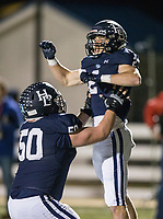 NWA Democrat-Gazette/BEN GOFF @NWABENGOFF<br /> Peyton Henderson (50), Springdale Har-Ber center, and Hunter Wood, Springdale Har-Ber wide receiver, celebrate after Wood made a touchdown catch in the third quarter vs Rogers Friday, Nov. 1, 2019, at Wildcat Stadium in Springdale.
