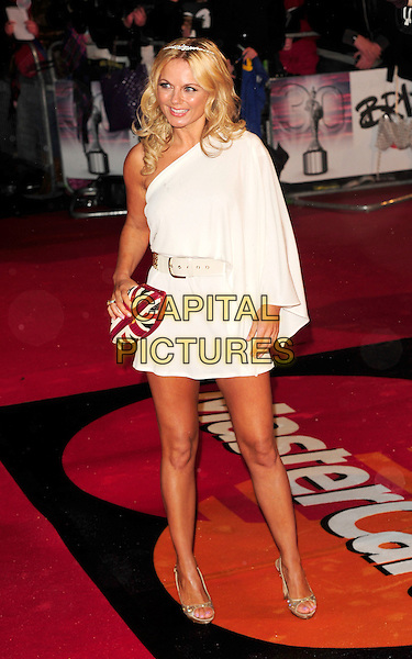 GERI HALLIWELL .At the Brit Awards 2010 held at Earls Court, London, England, UK,.February 16th 2010 .Brits arrivals full length white one shoulder sleeve dress union jack clutch bag grecian gold shoes open toe tanned tiara hairband hair head band headband waist belt .CAP/CJ.©Chris Joseph/Capital Pictures