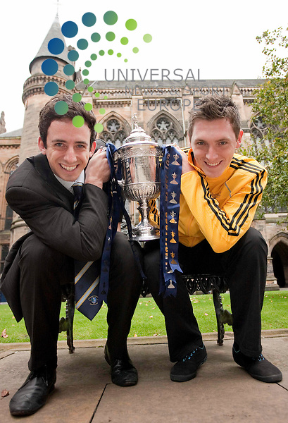 Glasgow University FC first team captains Gary Rodger(23) from Darvel Ayrshire and Calum Tevendale, (21) Darlington get ready for their their cup campaign on Saturday with a home tie against Burntisland Shipyard, with the Scotttish cup at the cloisters of Bute hall Glasgow University .Johnny Mclauchlan/Universal News and Sport (Scotland) 23/09/2010
