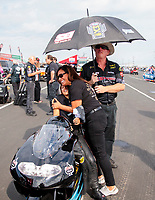 Sep 1, 2019; Clermont, IN, USA; NHRA pro stock motorcycle rider Jianna Salinas with mother Monica Salinas during qualifying for the US Nationals at Lucas Oil Raceway. Mandatory Credit: Mark J. Rebilas-USA TODAY Sports