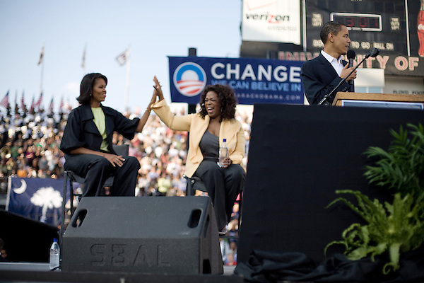December 9, 2007. Columbia, SC.. Democratic presidential hopeful and US Senator, Barack Obama held a rally for an estimated 29,000 people at the University of South Carolina's football stadium with special guest Oprah Winfrey.. Michelle Obama and Oprah high five as Barack Obama speaks.. .