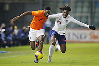 19th November 2019, Stadion De Vijverberg, Doetinchem, Netherlands; U-21 International football freindly, Netherlands versus England;  Netherlands player Deyovaisio Zeefuik and England player U21 Ebere Eze challenge for the ball
