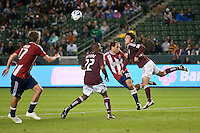 CARSON, CA – MARCH 26: Chivas USA Nick LaBrocca (10) and Colorado Rapids defender Kosuke Kimura (27) during the match between Chivas USA and Colorado Rapids at the Home Depot Center, March 26, 2011 in Carson, California. Final score Chivas USA 0, Colorado Rapids 1.