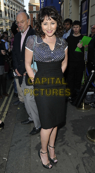 "Frances Ruffelle.The ""Merrily We Roll Along"" press night, Harold Pinter Theatre, Panton Street, London, England..May 1st, 2013.full length blue polka dot blouse black skirt.CAP/CAN.©Can Nguyen/Capital Pictures."