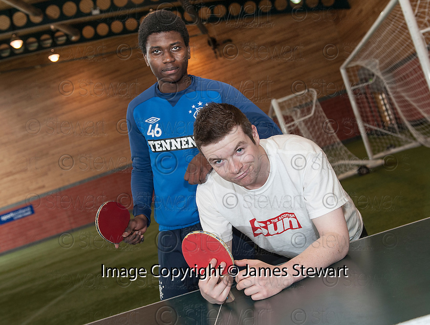 Sun Sport reporter Kenny Millar is down and out after being comprehensively beaten in a Table Tennis Challenge Match by Rangers' Junior Ogen .