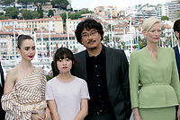 Actors Lily Collins (L-R), Ahn Seo-Hyun, director Bong Joon-Ho and actress Tilda Swinton attend the photocall of the movie 'Okja' during the 70th Annual Cannes Film Festival at Palais des Festivals in Cannes, France, on 19 May 2017. - NO WIRE SERVICE · Photo: Hubert Boesl/dpa /MediaPunch ***FOR USA ONLY***