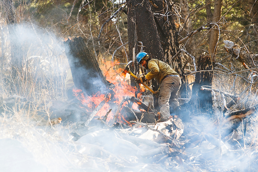 Firefighters battle a wildfire in Bear Trap Canyon on the Madison River in the Lee Metcalf Wilderness.