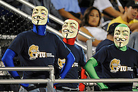 25 October 2011:  FIU fans watch the instant replay on the stadium's video scoreboard in the second half as the FIU Golden Panthers defeated the Troy University Trojans, 23-20 in overtime, at FIU Stadium in Miami, Florida.