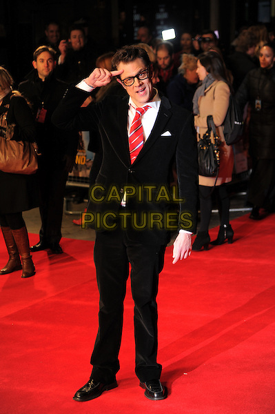 Johnny Knoxville.'The Last Stand' UK film premiere at Odeon West End cinema, Leicester Square, London, England..22nd January 2013.black glasses full hand arm salute length suit white shirt red tie .CAP/CAS.©Bob Cass/Capital Pictures.