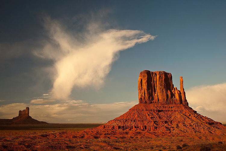 Unique cloud formation over the Left Mitten rock formation in Monument Valley