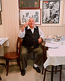 TURKEY, Istanbul, portrait of a Mr. Refik sitting in his Refik Restaurant