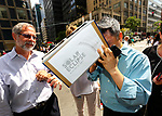 NEW YORK - AUGUST 21:  People Look Through Home Made Eclipse Viewers Made Out of Cardboard Box As They Try and View The Full Total Eclipse On And Near 42nd Street By Grand Central August 21, 2017 in New York City.