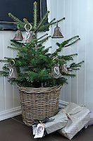 The small Christmas tree has been decorated with rattan bells from Pineapple and Askim