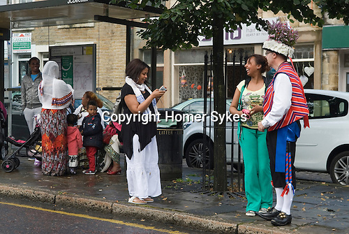 Uppermill Saddleworth Yorkshire Uk. Ethiopian family meet a Saddleworth Morris man. Multicultural England. The Ethiopian family have lived in the area for 10 yrs.