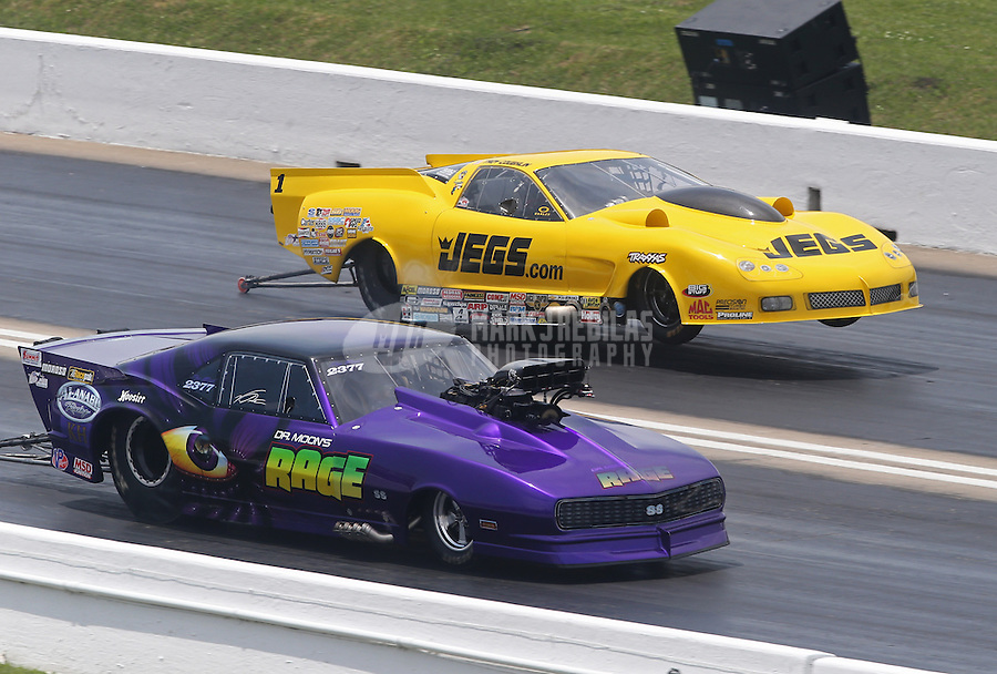 Apr. 28, 2013; Baytown, TX, USA: NHRA pro mod driver Von Smith (near) races alongside Troy Coughlin in a wheelstand during the Spring Nationals at Royal Purple Raceway. Mandatory Credit: Mark J. Rebilas-