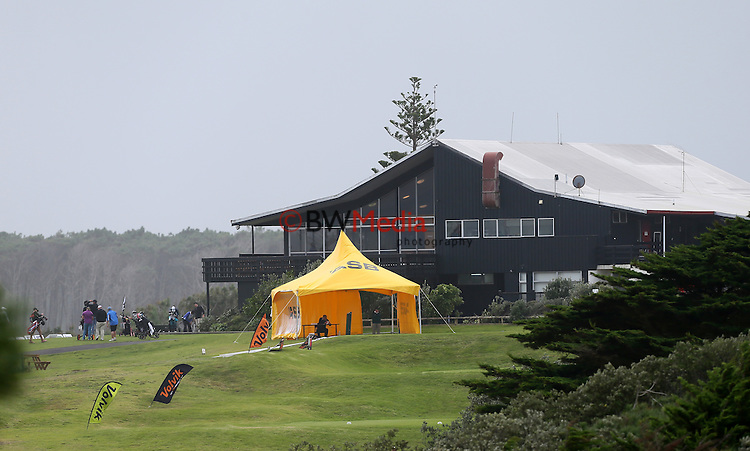 General view of the clubhouse as the wind rips through Muriwai during the Autex Muriwai Open, Round One, Charles Tour, Muriwai Golf Course, Auckland, New Zealand. Thursday 30 April 2015. Photo: Simon Watts/www.bwmedia.co.nz <br /> All images &copy; NZ Golf and BWMedia.co.nz New Zealand Golf Images:<br />