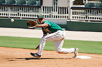 Carlos Lopez (7) of the Greensboro Grasshoppers waits for a throw at first base during the game against the Kannapolis Intimidators at CMC-NorthEast Stadium on September 1, 2014 in Kannapolis, North Carolina.  The Grasshoppers defeated the Intimidators 7-4.  (Brian Westerholt/Four Seam Images)