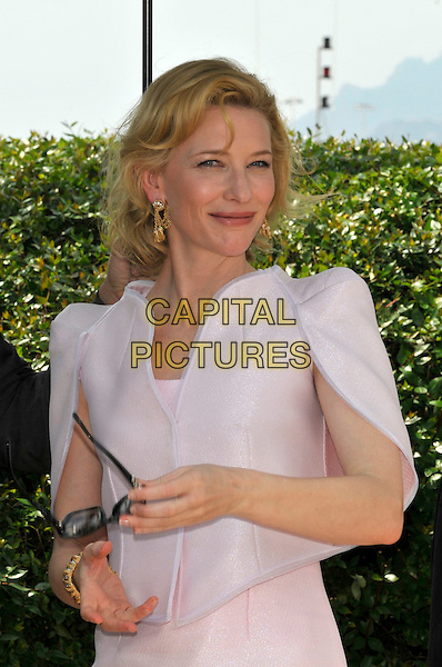 "CATE BLANCHETT.""Robin Hood' photocall.63rd International Cannes Film Festival, France.12th May 2010.sunglasses shades hand bracelet pink gold earrings half length jacket shoulder pads.CAP/PL.©Phil Loftus/Capital Pictures."
