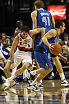04/03/11--Blazers' Rudy Fernandez works his way around a pick by Mavericks' Dirk Nowitzki in the second half at the Rose Garden in Portland, Or.. Portland defeated Dallas 104-96.Photo by Jaime Valdez........................................