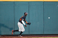 Miami Hurricanes outfielder Jacob Heyward (24) scrambles for the baseball off the wall against the Florida Gators in the NCAA College World Series on June 13, 2015 at TD Ameritrade Park in Omaha, Nebraska. Florida defeated Miami 15-3. (Andrew Woolley/Four Seam Images)