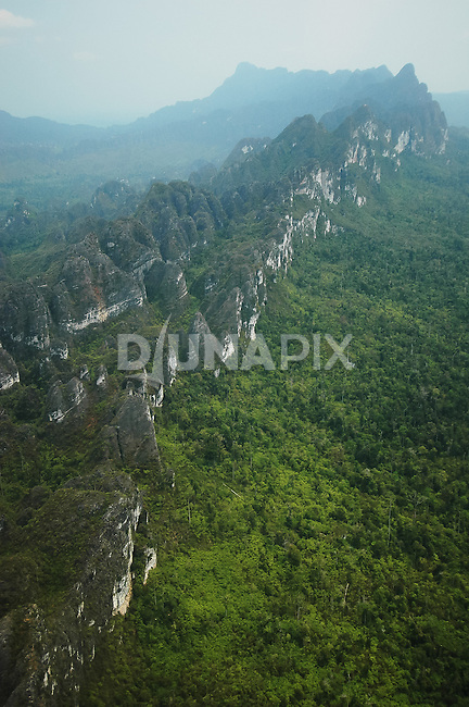 Karst escarpments and doline fields between Marang and Danau Tebo, Sangkulirang, East Kaliamantan.