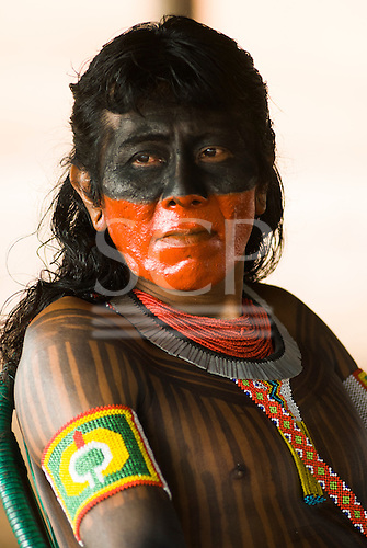 Pará State, Brazil. Aldeia Kokraimoro (Kayapo). Koti Kayapo with bright red urucum and black genipapo face paint.