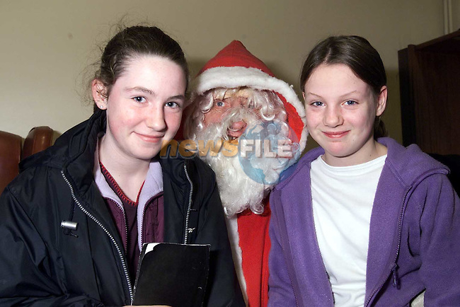 Alison Rooney, Dromin and Lynn Carolan, The Orchards with Santa in the Ardee Day Care Centre..Picture: Paul Mohan/Newsfile