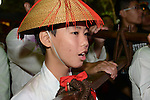 Donggang, Taiwan -- Young Taoist believer taking part in the religious proceedings before the King Boat is set ablaze.