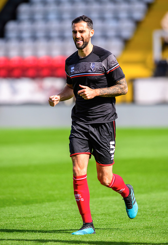 Lincoln City's Adam Jackson during the pre-match warm-up<br /> <br /> Photographer Chris Vaughan/CameraSport<br /> <br /> The EFL Sky Bet League One - Saturday 12th September 2020 - Lincoln City v Oxford United - LNER Stadium - Lincoln<br /> <br /> World Copyright © 2020 CameraSport. All rights reserved. 43 Linden Ave. Countesthorpe. Leicester. England. LE8 5PG - Tel: +44 (0) 116 277 4147 - admin@camerasport.com - www.camerasport.com - Lincoln City v Oxford United