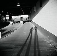 Long shadows of two figures<br />