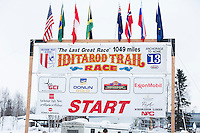 Iditarod start banner at the restart of the Iditarod sled dog race in Willow, Alaska Sunday, March 3, 2013.