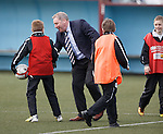 Ally McCoist taking the ball from the ballboys after the match for a laugh