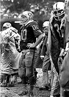 Oakland Raider center Jim Otto standing in the mud and rain....(1969 photo/Ron Riesterer)