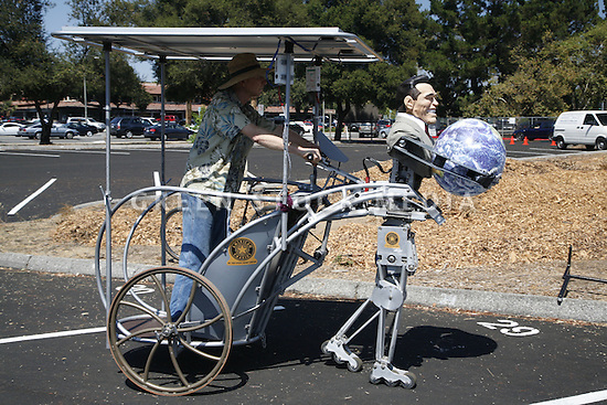 Profile shot of Bob Schneeveis driving his Terminator-like solar powered chariot invention. Contact Green Stock Media to view additional images from this photo shoot. ..Image size: 4368 x 2912 pixels, very high resolution, 12.8 megapixels