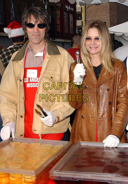 DAVID E. KELLEY & MICHELLE PFEIFFER.volunteer as The Los Angeles Mission Serve Up Holiday Cheer for the Homeless of Skid Row in Downtown Los Angeles, California on Christmas Eve .24 December 2003  .**UK Sales Only**   .food, funny   .www.capitalpictures.com.sales@capitalpictures.com.©Capital Pictures.