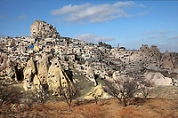 Town of Uchisar, in Pigeon Valley near Goreme, in Nevsehir province, Cappadocia, Central Anatolia, Turkey. In the centre is Uchisar Castle, the highest point in Cappadocia, with many rooms carved out of the rock. Many of the houses are carved into the soft volcanic rock, and the rock formations surrounding the town were made by erosion of the volcanic tuff created by ash from volcanic eruptions millions of years ago. This area forms part of the Goreme National Park and the Rock Sites of Cappadocia UNESCO World Heritage Site. Picture by Manuel Cohen