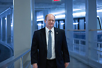 United States Senator Chris Coons (Democrat of Delaware) walks through the Senate Subway during a cloture vote on a Coronavirus Stimulus Package at the United States Capitol in Washington D.C., U.S., on Monday, March 23, 2020.  Credit: Stefani Reynolds / CNP/AdMedia