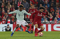 Liverpool's Mohamed Salah under pressure from Bayern Munich's Kingsley Coman<br /> <br /> Photographer Rich Linley/CameraSport<br /> <br /> UEFA Champions League Round of 16 First Leg - Liverpool and Bayern Munich - Tuesday 19th February 2019 - Anfield - Liverpool<br />  <br /> World Copyright © 2018 CameraSport. All rights reserved. 43 Linden Ave. Countesthorpe. Leicester. England. LE8 5PG - Tel: +44 (0) 116 277 4147 - admin@camerasport.com - www.camerasport.com