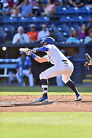 Asheville Tourists right fielder Yonathan Daza (2) lays down bunt during game one of a double header against the Kannapolis Intimidators at McCormick Field on May 21, 2016 in Asheville, North Carolina. The Tourists defeated the Intimidators in game one 3-2. (Tony Farlow/Four Seam Images)