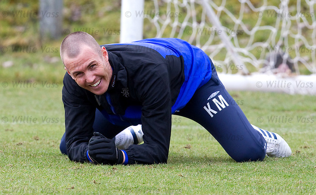 Kenny Miller laughing as he stretches