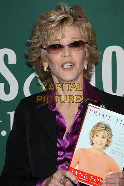"""Jane Fonda.Jane Fonda Book Signing for """"Prime Time: Love, Health, Sex, Fitness, Friendship, Spirit - Making the Most of All of Your Life."""" held at Barnes & Noble, The Grove, Los Angeles, California, USA..August 15th, 2011.half length black purple silk satin shirt blouse suit jacket sunglasses shades mouth open.CAP/ADM/RE.©Russ Elliot/AdMedia/Capital Pictures."""